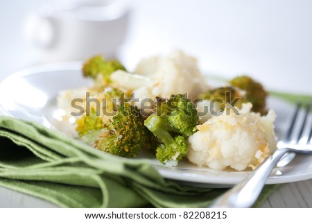 Broccoli and cauliflower gratin with cheese - stock photo