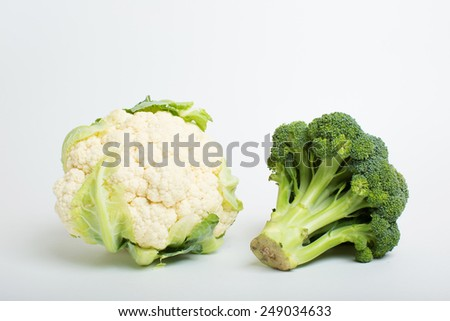 Broccoli and cauliflower on a white background - stock photo