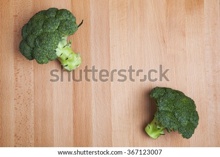Broccoli at the table - stock photo