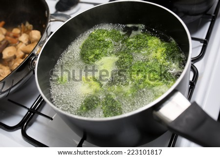Broccoli boiling in a pot - stock photo