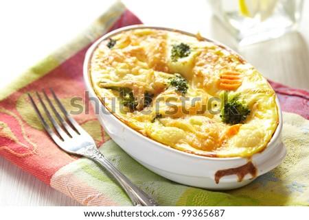 Broccoli, cauliflower and carrot gratin - stock photo