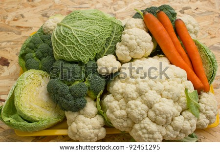 Broccoli, cauliflower, kale, cabbage and carrots on wooden background - stock photo