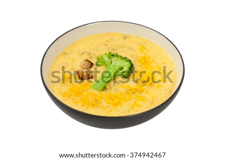 Broccoli Cheddar Soup isolated on a white background. Selective focus. - stock photo