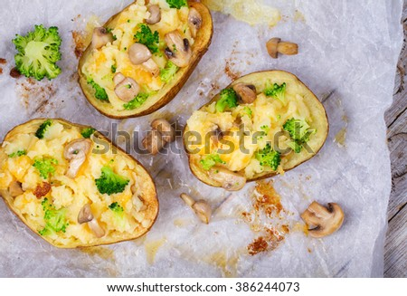Broccoli, Cheese and Mushroom Chowder Potato. View from above, top studio shot - stock photo