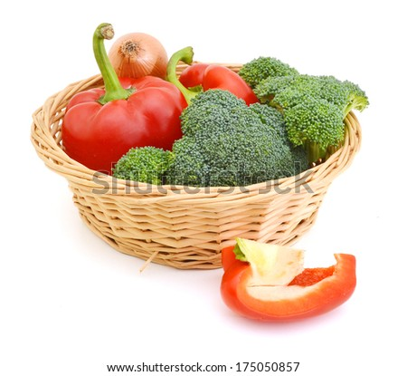 Broccoli , onion and slice red peppers in basket on white  - stock photo