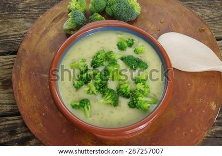 broccoli soup on dark wooden background - stock photo