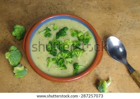 broccoli soup on stone background - stock photo