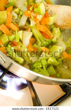 broccoli stir fry with carrots onions red peppers and other vegetables - stock photo