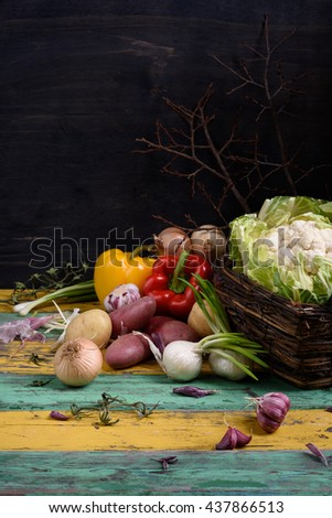 Broccoli with fresh raw vegetables, healthy cooking ingredients on rustic wooden table. Vegetarian diet background. - stock photo