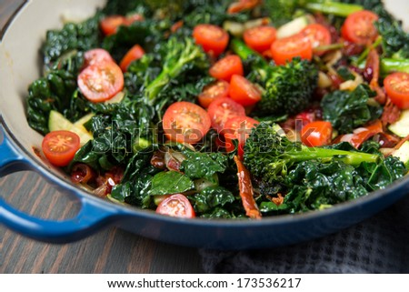 Broccolini, Cherry Tomatoes, Italian Kale, and Onions Sauteed in Skillet for Healthy Meal - stock photo
