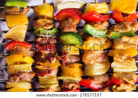 brochette on the grill - stock photo