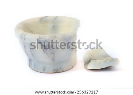 Broken antique white marble stoneware  pot on a white background - stock photo