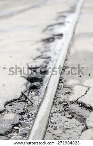 Broken asphalt road close up - stock photo