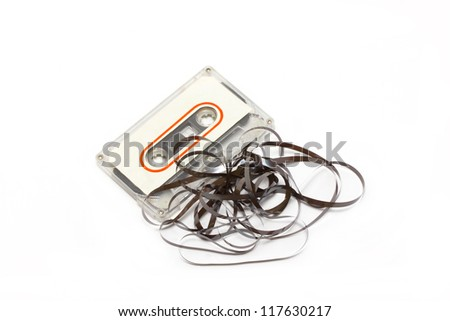 Broken audio cassette with label isolated on white background. - stock photo