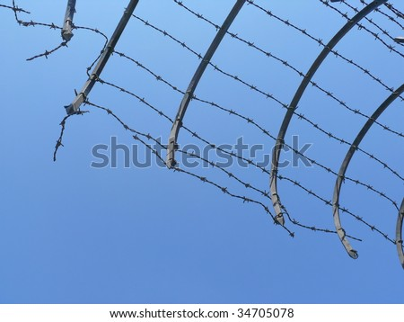 Broken barbed wire closeup. More of this motif in my port. - stock photo