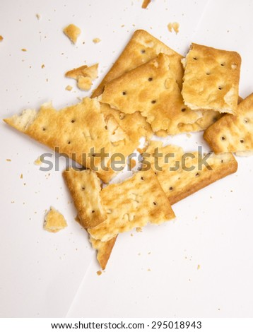 broken biscuits isolated on white background - stock photo