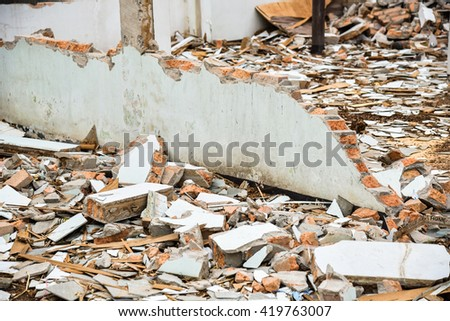 broken bricks from collapsed building - stock photo