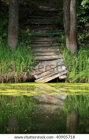 Broken bridge over the river - stock photo