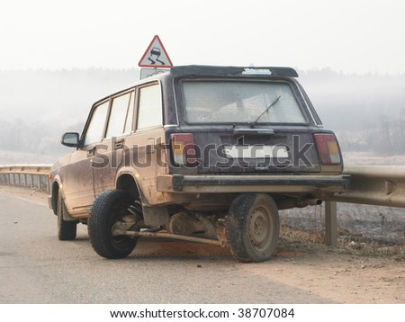 broken car on road . - stock photo