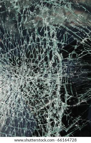 Broken car windshield made of laminated glass - stock photo