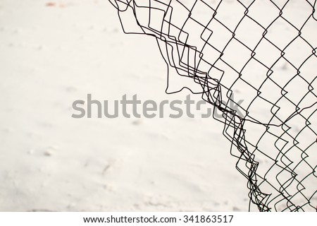 Broken chain link fence with a snow white background - stock photo