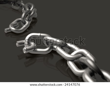 Broken chain with depth of field effect. - stock photo