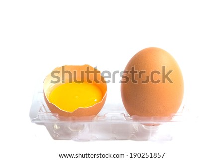 broken chicken eggs and egg yolk - stock photo