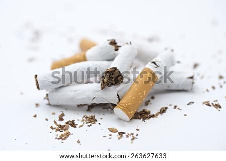 Broken cigarette isolated on white background - stock photo