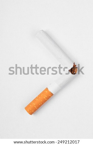 Broken cigarette isolated on white background - World No Tobacco Day - stock photo