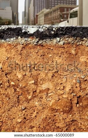 broken city road excavation earthquake cross section - stock photo