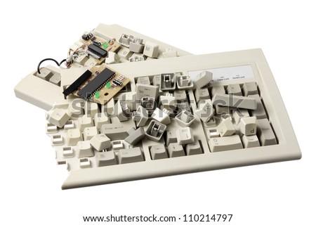 Broken Computer Keyboard on White Background - stock photo