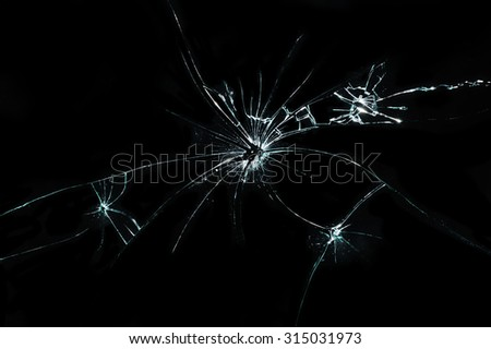 broken cracked glass with hole - stock photo