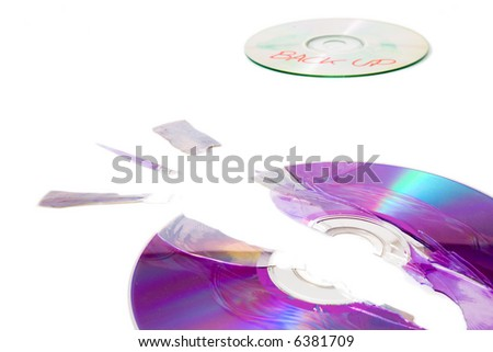 Broken disc and backup - stock photo