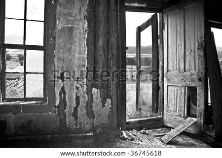Broken door in an abandoned cabin - stock photo