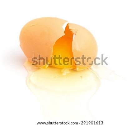 broken egg on a white background - stock photo