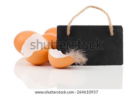 broken egg with blackboard with space for text , on white background - stock photo