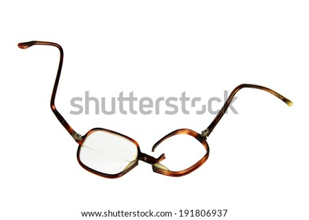 Broken Eyeglasses on White Background - stock photo
