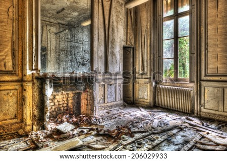 Broken fireplace in an abandoned derelict room, HDR - stock photo