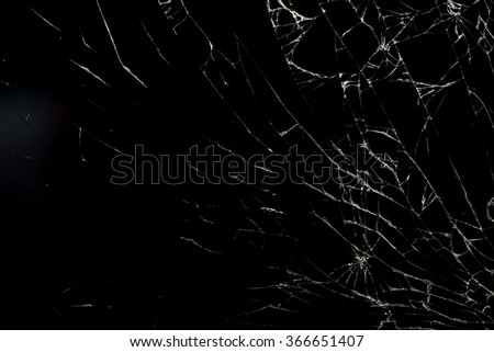 Broken flat glass of tablet device on black - stock photo