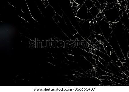Broken flat glass of tablet device on black - stock photo
