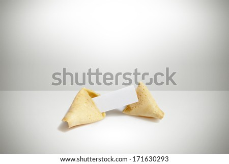 broken fortune cookie with paper tag - stock photo
