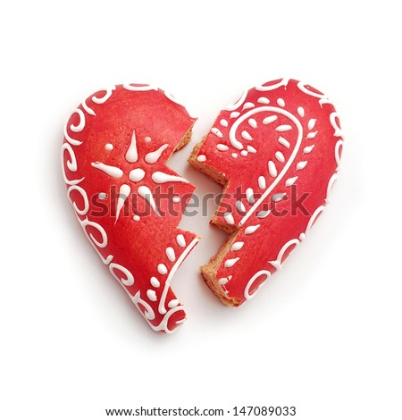 broken gingerbread heart on white - stock photo