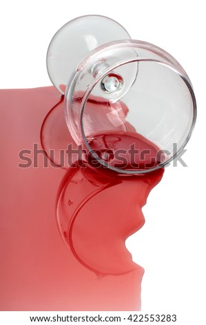 Broken glass and spilled red wine on white background - stock photo