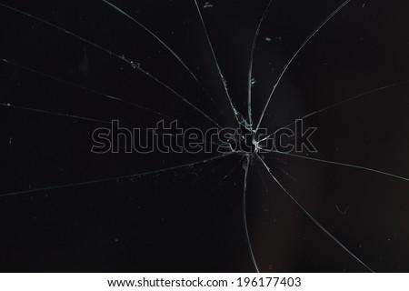 broken glass black background - stock photo
