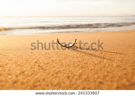 broken glass bottle in the sand - stock photo