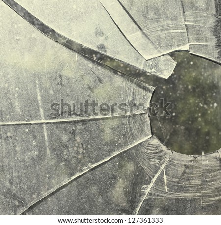 Broken glass fragments above white/ Abstract background texture. - stock photo