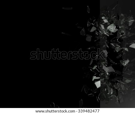 Broken glass from the blow, shot on a black isolated background with space for Your text or image - stock photo