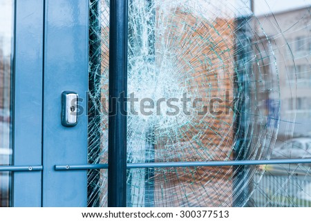 Broken glass front door - stock photo