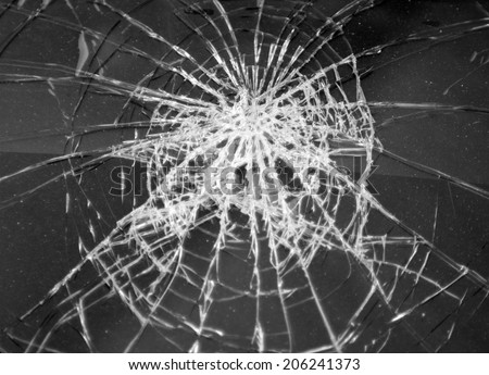 Broken glass in car. Abstract black-and-white background - stock photo
