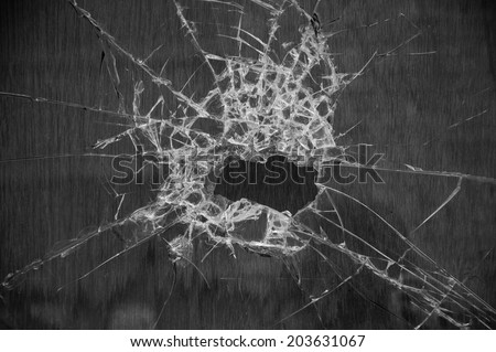 Broken glass of empty signboard. Wooden panel at background. Aged photo. Black and white. - stock photo